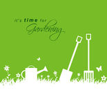 Its time for gardening .Spring gardening background with spade,. Rake and watering can sample Stock Photography
