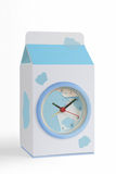 It's time for milk. A table analogue clock shot on white background Royalty Free Stock Images
