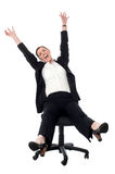It's time to celebrate. Yippee!. Business lady rejoicing in madness Royalty Free Stock Images
