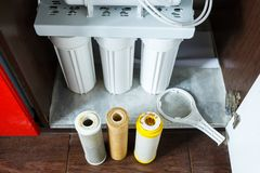 It`s time to change water filters at home.  Replace filters in water purifying system. Close up view  of three used filters. Clean water at home royalty free stock photos