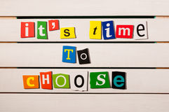 It's time to choose - written with color magazine letter clippings on wooden board. Concept  image Royalty Free Stock Images