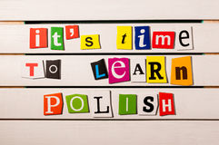It's time to learn Polish - written with color magazine letter clippings on wooden board. Concept image.  Stock Photography