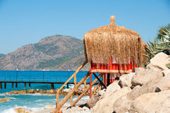 It's time to leave. Bungalow on the beach. Stock Image