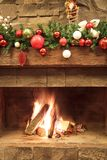 New Year / Christmas tree with colorful festive decorations on the fireplace Stock Images