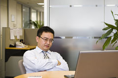 It's time to stop and think. Asian business executive doing some thinking in his office Royalty Free Stock Photo