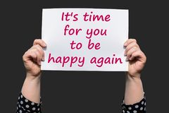 It`s time for you to be happy again. Motivational sign woman holding by hand royalty free stock image
