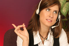 She's in touch. Discussion over the phone girl talks threw her headset Royalty Free Stock Photography