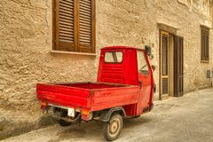I Got The Tricycle Truck Shutters. Tricycle trucks, shuttered windows and doors on narrow streets. That`s Favignana, Sicily stock photography