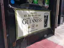 Happy Saint Patrick`s Day Banner, Irish Pub, NYC, NY, USA. It`s two days before St. Patrick`s Day and this Irish pub in Midtown Manhattan is ready! This photo Stock Photo