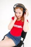 słuchawki minispódniczka dziewczyny Obrazy Stock