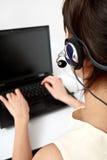 słuchawki notatnika operator Zdjęcie Stock