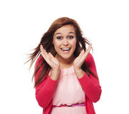 It's unbelievable!. Young surprised woman with hand next to her face Royalty Free Stock Photos