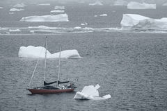 S/V Northanger navigating through the icebergs, Lemaire Channel, Antarctica. S/V Northanger navigating through the icebergs. January 1, 2013 - Lemaire Channel Royalty Free Stock Image
