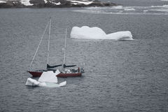 S/V Northanger navigating through the icebergs, Lemaire Channel, Antarctica. stock photography