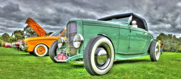1930s vintage Ford. 1930s American green Ford Roadster with black soft top roof on display at car show in Melbourne, Australia Royalty Free Stock Photo
