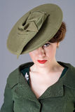Forties vintage vogue style high fashion woman. 40s vogue style beauty model in vintage green hat and coat Royalty Free Stock Image