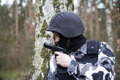 S.W.A.T soldier. A lonely S.W.A.T ranger in the forest Royalty Free Stock Photo