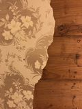 1920s wallpaper. Wallpaper from the 1920s on a wooden wall Royalty Free Stock Images