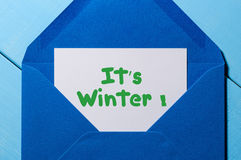 It`s Winter - text message in blue envelope. Eve, Christmas and New Year concept Stock Photography