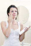 30s Woman Applying Moisturising Cream Royalty Free Stock Images