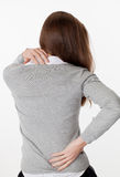 20s woman in back view with spine ache and tension Royalty Free Stock Photography