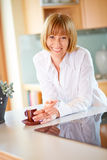 40s woman with cup of coffee at home Stock Images
