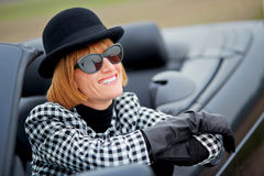 40s woman happy with new Convertible Royalty Free Stock Photos