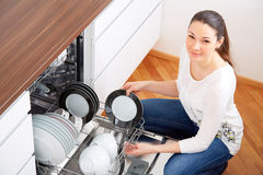 20s woman in kitchen, empty out the dishwasher 8 Stock Images