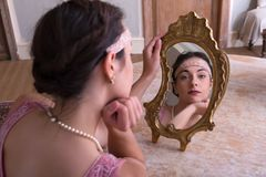 1920s woman looking in mirror royalty free stock photo