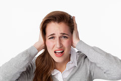 20s woman stressed by noise,covering her ears Stock Photos