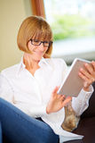 40s woman using tablet-pc at home Royalty Free Stock Photo
