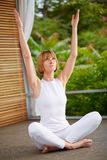 40s woman at yoga, outside Stock Images