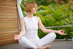 40s woman at yoga Royalty Free Stock Images