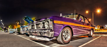 1970s X series Ford Falcons at night Royalty Free Stock Image