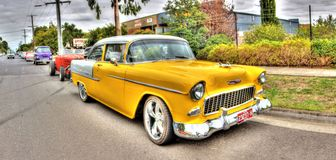 1950s yellow Chevy parked in street Stock Photo