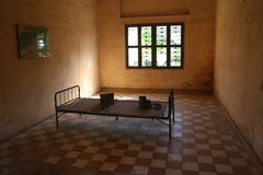 S21 Prison bed. A Prison bed used by the khmer rouge to torture prisoners at the s21 prison.  More than 11,000 prisoners were sent here and only six survived Stock Photo