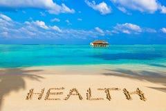 Saúde da palavra na praia foto de stock