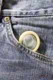 Saúde - preservativo no bolso das calças de brim Imagem de Stock Royalty Free
