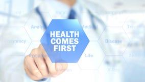 A saúde vem primeiramente, doutor que trabalha na relação holográfica, gráficos do movimento foto de stock