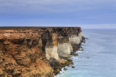 SA Bight Cliffs close. Close view of dangerous falling cliffs of South AUstralia Nullbarob plain coastline facing Great Australian Bight. Mighty ocean undermines stock images