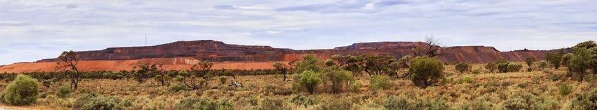 SA Iron Knob Horiz panorama. Wide horizontal panorama of open pit iron ore mine in South Australia - Iron Knob town Stock Photos
