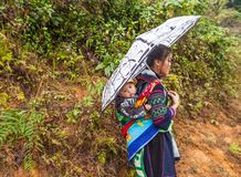 Sa pa, VIetnam. Black Hmong woman with a child royalty free stock photography