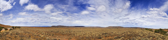 SA Plain 2 Pt Augusta 180 panorama. Wide 180 degrees panorama of endless plains in Australian outback on a summer sunny day. Fenced highway with flat distant Stock Images
