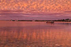 SA Streaky bay pink seabed. Clear transparent still water of bay in Streaky bay town in SOuth Australia. Majesting majenta sunset reflecting on seabed during low stock photo