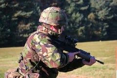 SA80 Firing. A Royal Marine firing an SA80 Rifle on the rifle range Stock Images