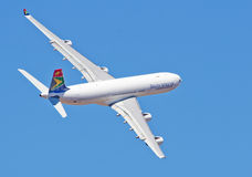 SAA does a low level fly past. PRETORIA, SOUTH AFRICA -SEPT. 23: A SAA Airbus 340 low level flypast at the African Aerospace & Defence show on Sept. 23, 2012 at royalty free stock photo