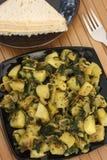 Saag Aloo Bhuna - piatto degli spinaci e della patata Fotografia Stock