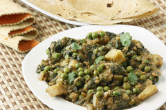 Saag Matter is an north Indian vegetarian dish. Saag Matter is prepared from Aloo (potatoes) , Palak(Spinach) Mutter (Peas) cooked with onion and Indian spices Royalty Free Stock Photos