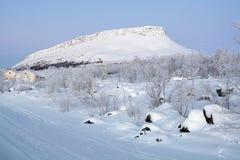 Saana Hill in winter, Finnish Lapland, Finland. Saana Hill during the polar twilight in winter, Kilpisjarvi village, Finnish Lapland, Finland Stock Photography