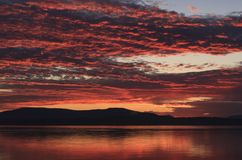 Saanich Inlet in British Columbia at sunset. Dramatic skies over Saanich Inlet in British Columbia, Canada, at sunset Royalty Free Stock Images